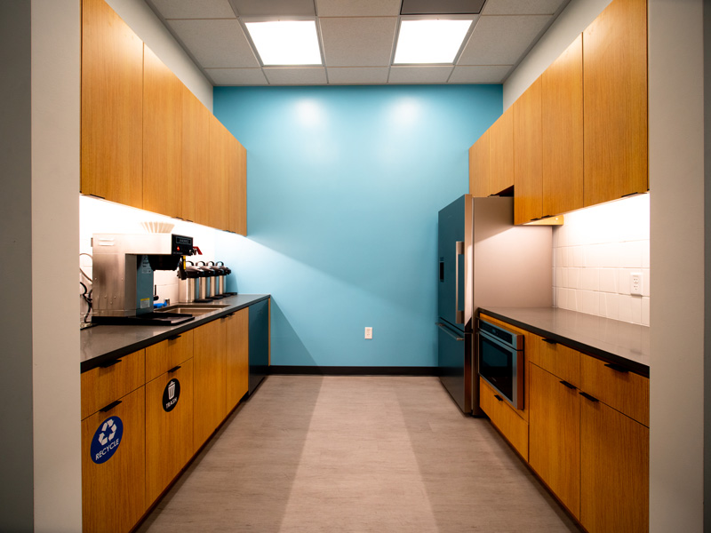 long view of office space kitchen with coffee
